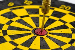 One darts in center of target  on white Stock Photography