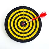 One darts in center of target  on white Royalty Free Stock Photography