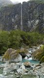 High waterfall on the way to Rob Roy´s glacier in Mount Aspiring national park, New Zealand stock image