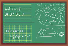 One day at the school. Numbers, children draw and letters written with white chalk on green blackboard with brown frame Royalty Free Stock Photography