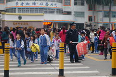 One day after school, students go out of the school gate Stock Photo