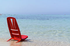 One day at the sea with the red chair Royalty Free Stock Photos