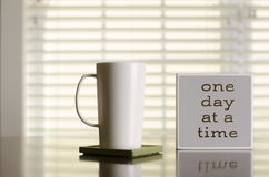 One day at a time coffee and tea inspiration. Mindset stock photography