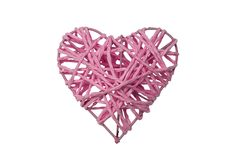 One pink woven heart. One decorative braided heart painted pink, isolated, on white background Stock Images