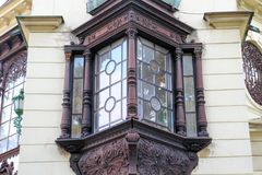 One design window on the facade of the old house.  Royalty Free Stock Photography