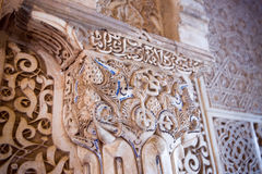 One detail of the arabesques. The arabesque is a form of artistic decoration consisting of surface decorations based on rhythmic linear patterns of scrolling Stock Photo