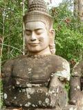 A Guardian God at the North Gate to Angkor Thom stock photos
