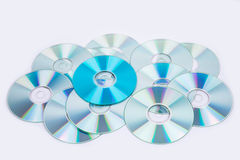 One blue and several normal CD DVD discs Royalty Free Stock Photo