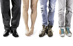 One of these is different. 4 pairs of legs with one naked and different Stock Images