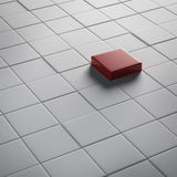 One different red cube Stock Photography