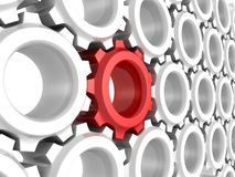 One different red gear wheel in other white crowd Royalty Free Stock Images