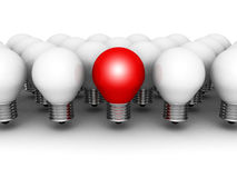 One different red light bulb in row of white ones Stock Photo