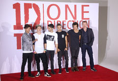 One Direction,Morgan Spurlock. One Direction, Harry Styles, Niall Horan, Liam Payne, Louis Tomlinson, Zayn Malik and Morgan Spurlock at the One Direction This is Stock Photo