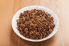 One dish of cereal breakfast. Without milk on woody table Royalty Free Stock Images