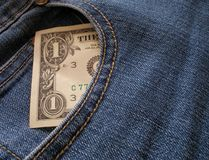 One dollar. Bill within pocket of blue jeans royalty free stock photo