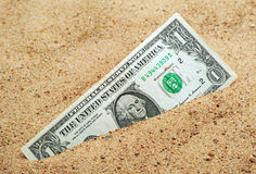 One dollar. In the sand stock image