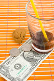 One dollar and 50 cent pay for drink and cookies Royalty Free Stock Images