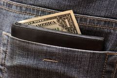 One dollar in the back pocket Royalty Free Stock Photo