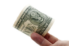 One dollar banknote in a fingers Royalty Free Stock Photography