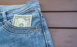 One dollar banknote. In jeans pocket Stock Photo