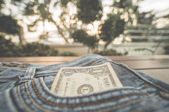 One dollar banknote. In jeans pocket Stock Photos