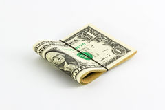 One dollar banknotes rolled up with rubberband. One dollar banknotes rolled up with rubberband isolate white background,Clipping Path Stock Image