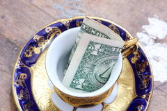 One dollar bill in classic cup Royalty Free Stock Photo