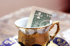 One dollar bill in classic cup Stock Photography
