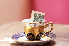 One dollar bill in classic cup Stock Photos