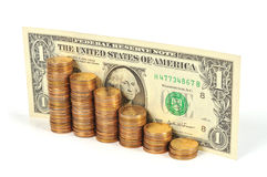 One dollar bill and coins stacked in the form of a graph of growth Stock Photos