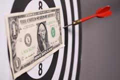 One dollar bill on a dartboard Stock Photos