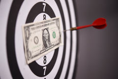 One dollar bill on a dartboard Stock Images