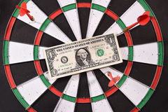 One dollar bill on a dartboard Royalty Free Stock Photos