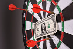 One dollar bill on a dartboard Royalty Free Stock Photo