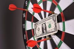 One dollar bill on a dartboard Royalty Free Stock Photo
