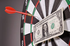 One dollar bill on a dartboard Royalty Free Stock Image