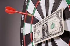 One dollar bill on a dartboard Royalty Free Stock Image