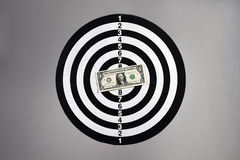 One dollar bill on a dartboard Royalty Free Stock Photography