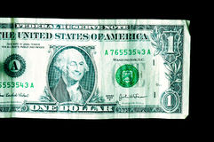 One dollar bill; George smiling and winking. One dollar bill close up; George Washington is smiling and winking Royalty Free Stock Image