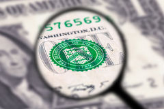 One dollar bill magnification glass Royalty Free Stock Images