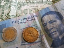 one dollar bill, 21 mexican pesos and 50 cents stock photography