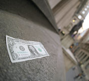 One dollar bill. One dollar note lying alone on the steps of the Federal Hall Royalty Free Stock Images