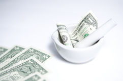 One Dollar Bill Placed in Mortar and Pestle Royalty Free Stock Photo
