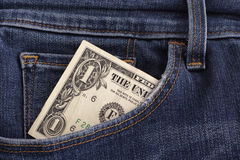 One dollar bill in a pocket of blue jeans Royalty Free Stock Images