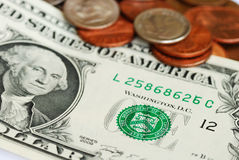 One Dollar bill and some coins Stock Photo