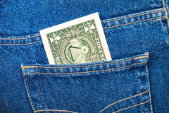 One dollar bill sticking out of the jeans pocket Stock Photos