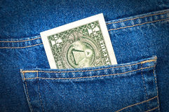 One dollar bill sticking out of the jeans pocket Royalty Free Stock Photo