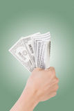 One dollar bill. Woman hand holding one dollar bill Royalty Free Stock Image