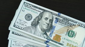 One dollar bills fall on a black table. Close-up of a one dollar bills fall on a black table. Business stock footage shot stock footage