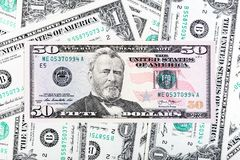 One dollar bills and fifty dollar banknote close-up photo. royalty free stock photos
